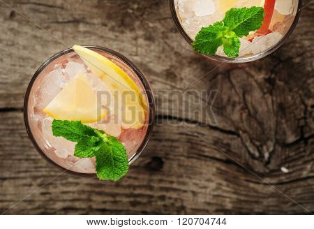 Summer Cocktail With Ice, Lemon, Apple And Mint