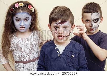 zombie apocalypse kids concept. Birthday party celebration facepaint on children dead bride, scar fa
