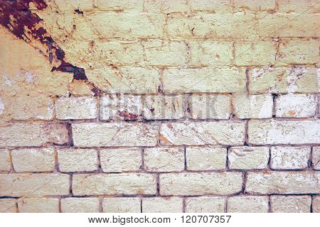 Weathered grey brick wall painted in two color for background or texture