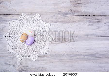 Easter Eggs With White Serviette On Wooden Background.