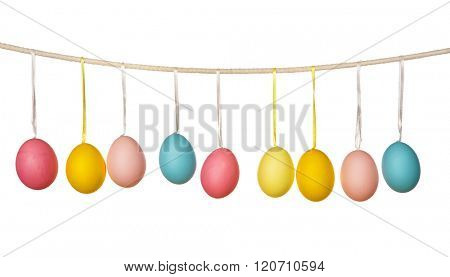 Easter eggs hanging on the clothesline isolated on white background