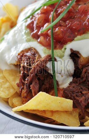 Image of tortilla chips with pulled pork