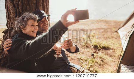 Senior Couple Taking A Selfie At The Lake