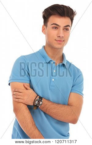 sexy young boy posing in isolated studio background looking away from the camera and touching his arm