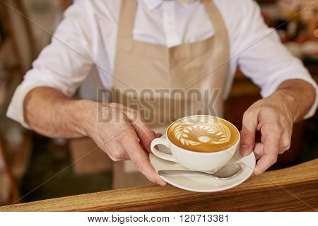 Barista Giving You A Cup Of Fresh Coffee