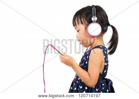 Asian Little Chinese Girl Using Mobile Phone With Headset