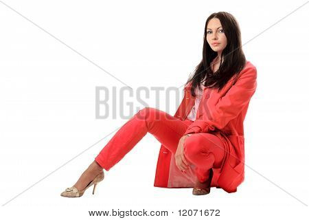 Pretty Young Woman In Red Suit. Isolated