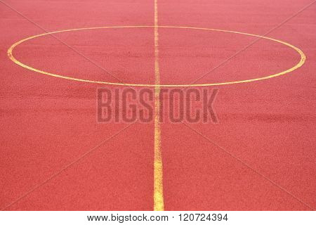 Soccer Field Made From Red Granule Rubber. Football Field Background. Center Of Play Ground
