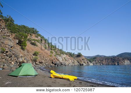 Traveling by kayak along the coast of the sea.