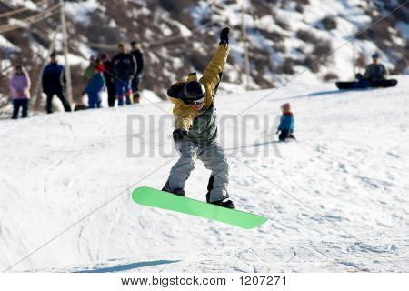 Flying Snowboarder On Green Board