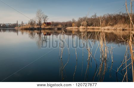 Fishing hut on the silent lake