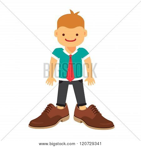 Small boy wearing a tie and fathers shoes
