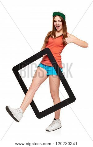 Teen funky girl standing with a frame