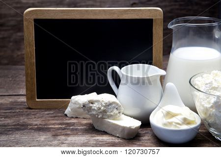 Milk and Camembert cheese with blackboard