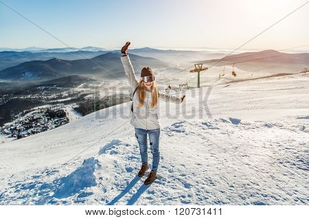 The girl on the background of the ski slopes