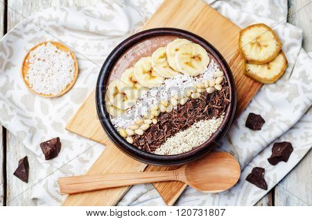 chocolate smoothie with banana coconut pine nuts chocolate and sesame seeds