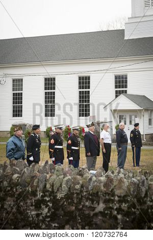 SUCCASUNNA, NJ-DEC 12, 2015: Veterans stand alongside active duty members of the U.S. Army and U.S. Marine Corps for the ceremonial wreath laying service for 2015 Wreaths Across America.