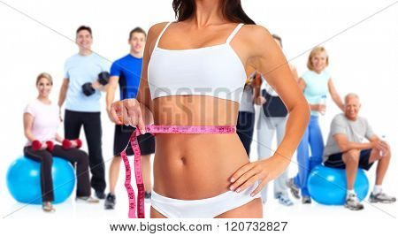 Woman waist with measuring tape over people group background.