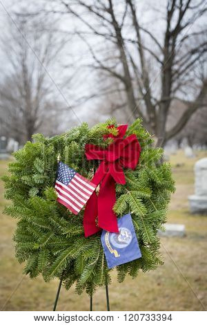 SUCCASUNNA, NJ-DEC 12, 2015: The U.S. Navy ceremonial wreath stands between the First Presbyterian and the United Methodist Church combined cemeteries in for the 2015 Wreaths Across America event.