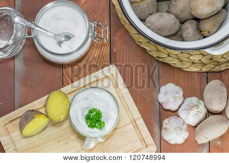 Jacket Potatoes Garlic Dip and Salt on Wooden Board