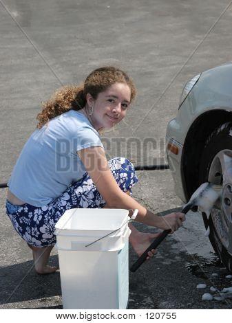 Teen Girl Washing Car