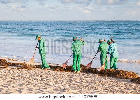 Hotel Workers In Green Uniform Engaged In Cleaning