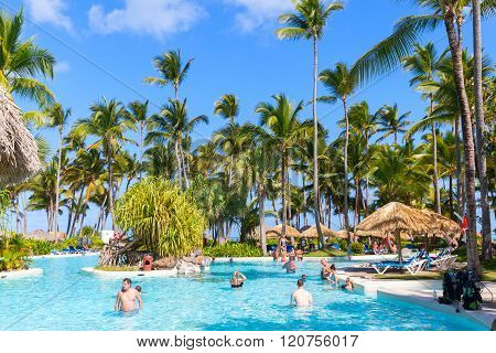 Tourists Relax In Punta Cana Resort Hotel With Pool