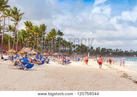 Atlantic Ocean Coast, Many Tourists Resting On Beach