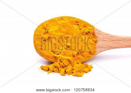 Pile of ground turmeric on a white background