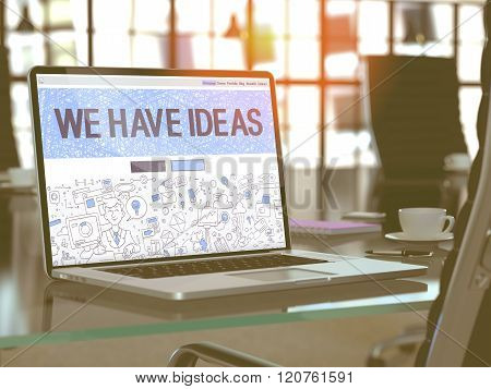 We Have Ideas on Laptop in Modern Workplace Background.