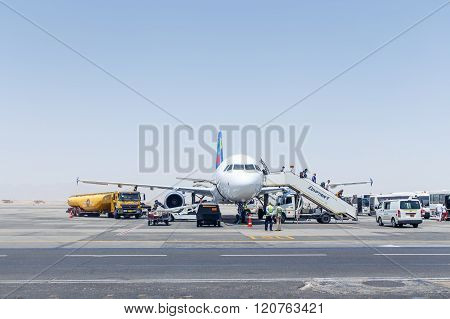 Disembarking Passengers From The Small Planet Airbus A320