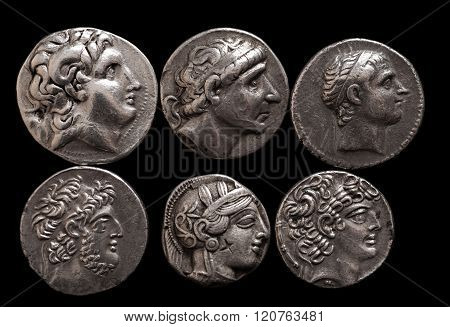 Ancient Greek Silver Coins With Portraits Of Rulers And Gods