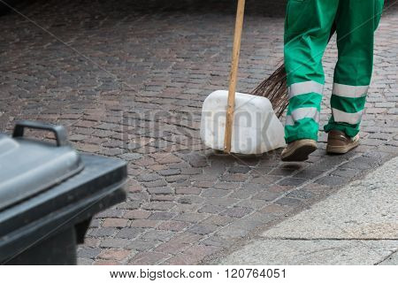 Municipal Dustman Worker With Cleaning Tools