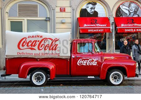 PRAGUE, CZECH REPUBLIC - Oct 23 2015: An old renovated red Ford vintage Coca cola truck (pickup) in
