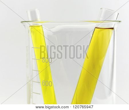 Test Tube With Yellow Liquid (fluid, Water) In The Beaker For Chemical, Isolated On White Background