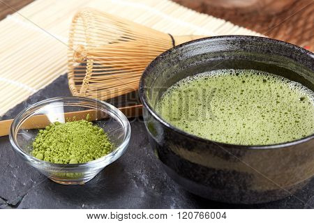 Green Matcha Powder And Tea Preparation