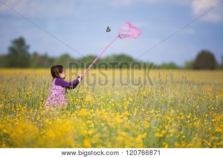 Young Girl Chasing Butterfly