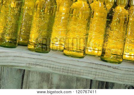 Yellow Drink Bottles On Wooden Shelf
