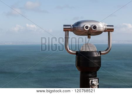 Sightseeing Binoculars Overlooking Ocean From Up High