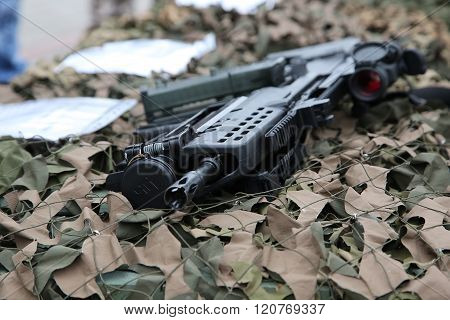 Rifle On The Camouflage Net