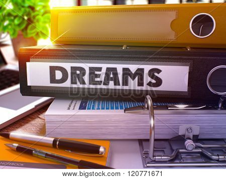 Dreams on Black Office Folder. Toned Image.