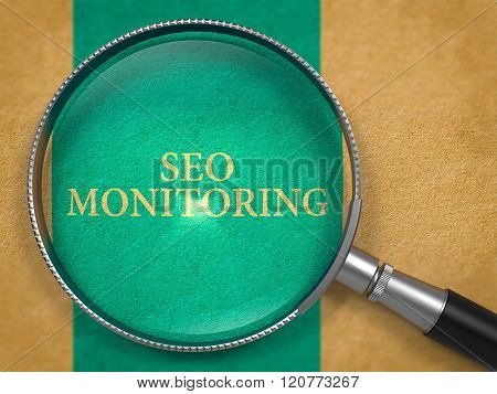 SEO Monitoring through Loupe on Old Paper.