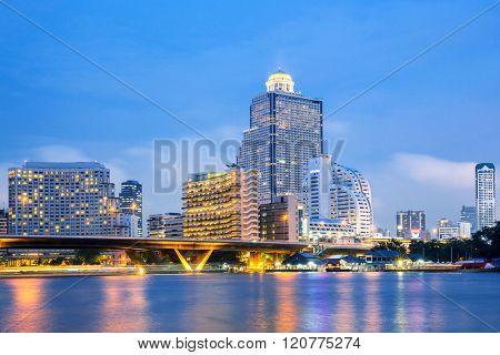 Bangkok Skyline along Chaophraya River sunset twilight