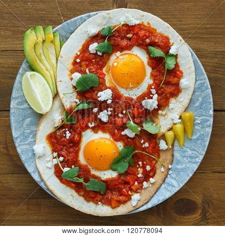 Mexican Breakfast Huevos Rancheros: Fried Egg With Salsa Closeup In The Pan
