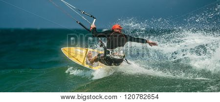 Handsome man Kite surfing in blue sea