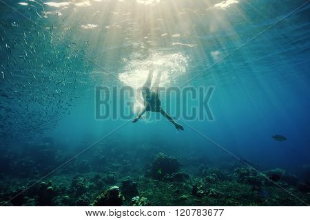 Attractive young woman floating in beautiful  ocean