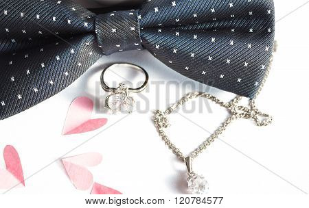 Romantic Composition  Pink Paper Hearts Ring And The Bow Tie