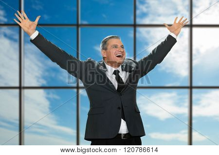 Happy laugh of mature businessman.