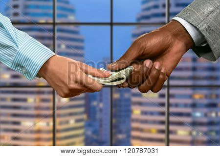 Megalopolis business couple passing money.