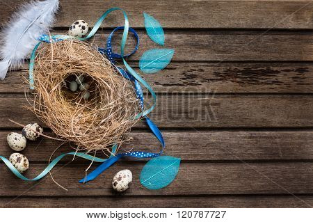 Easter Background With Eggs In Nest On Rustic Wooden Board